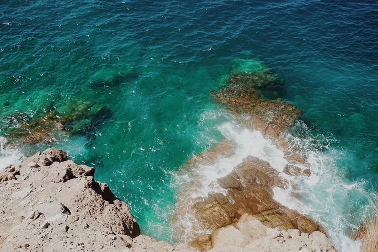 coastline Coastline Coastal Feature Coastal Coastline Landscape Aerial View Waves, Ocean, Nature Waves Sea Water Sea Beach Sand High Angle View Backgrounds Turquoise Rushing Wave Crashing Power In Nature Seascape Horizon Over Water Rocky Coastline Tide Clear Turquoise Colored UnderSea Shore