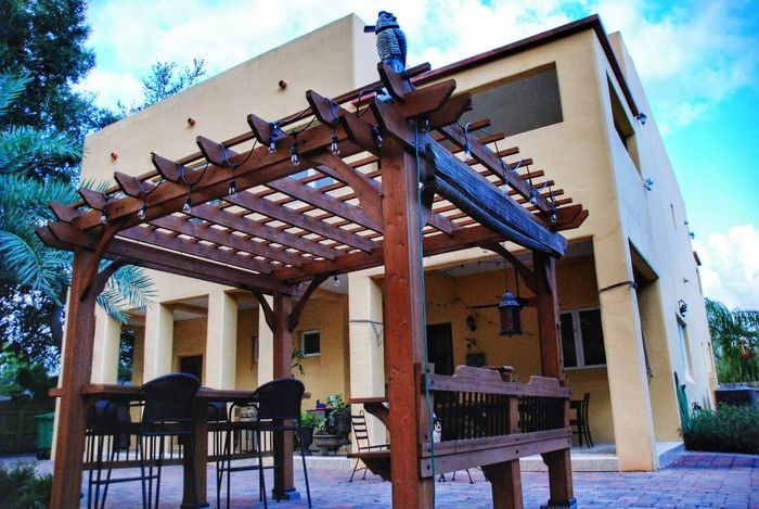 Architecture Built Structure Building Exterior Sky Architectural Column Cloud Cloud - Sky Outdoors Day Luxury Home Home Decor Backyard Pergola Mediterranean Style Tampa Florida Home Perspective Balcony Stucco Dramatic Angles The Architect - 2017 EyeEm Awards Paint The Town Yellow The Architect - 2018 EyeEm Awards