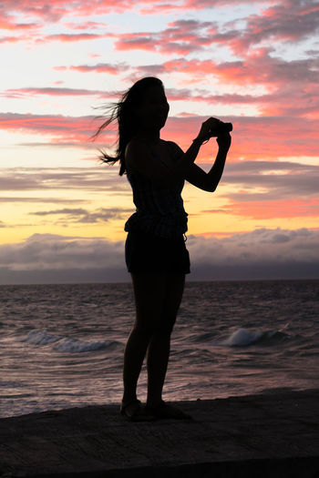 Photographer girl with camera on a stunning sunset beach Beach Sunrise Beach Sunset Digital Nomad Dslr Camera Girl Island Girl Island Sunset Island View  It's More Fun In The Philippines Philippines Photograper Silhouette Photographer Photographer Outline Pink Sky Profile Silhouette Sunrise Sunset Taking A Photo Taking A Picture Taking Pics Travel Wandering Woman World Traveller
