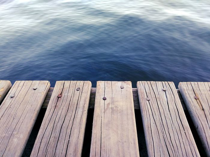 High angle view of wooden pier on calm sea