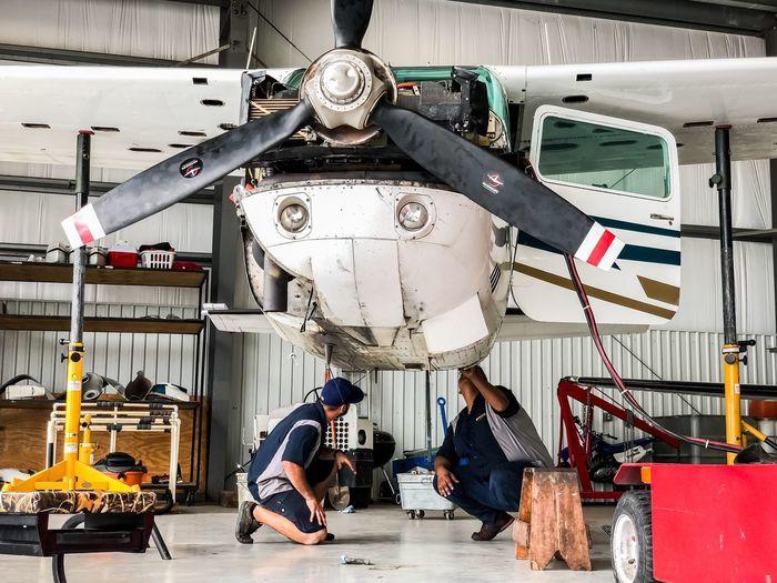 Man working at airplane
