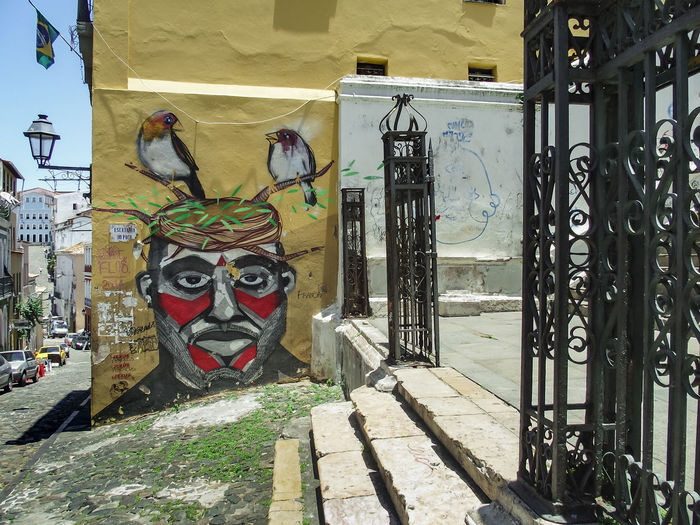 colonial square with graffity and iron gates in brazil Animal Representation Bird Paiting Colonial And Graffiti Colonial And Graffitp Colonial Architecture Colonial City Square Day Graffiti No People Outdoors