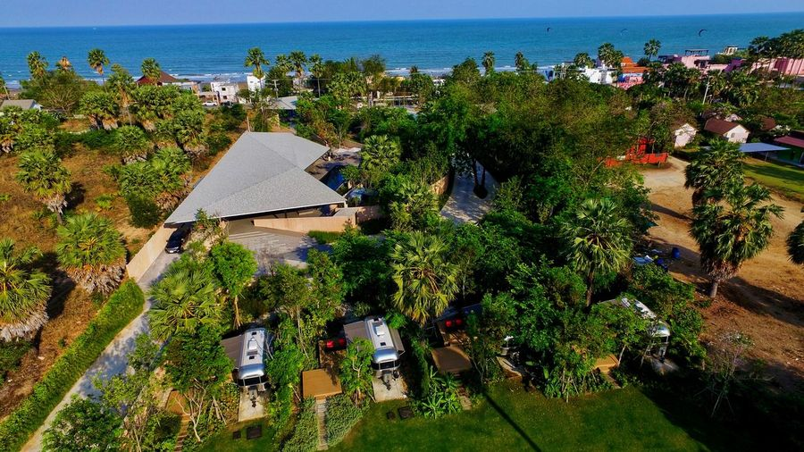 Sea Sea Thailandtravel Campground Camping Plant Water Growth Sea Nature High Angle View Day Tranquil Scene No People Beauty In Nature Tranquility Land Sunlight Green Color Beach Outdoors Flower Sky Scenics - Nature