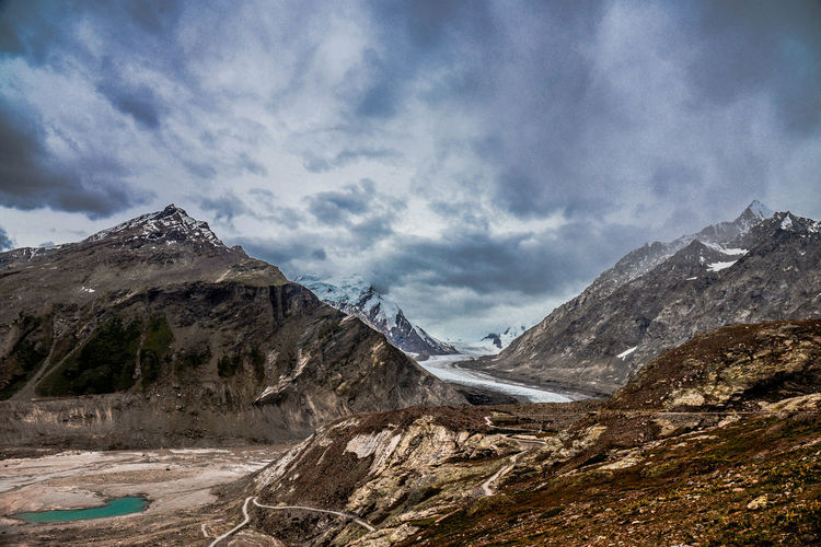 Scenic View Of Rocky Mountains Against Cloudy Sky At Drang Drung Glacier