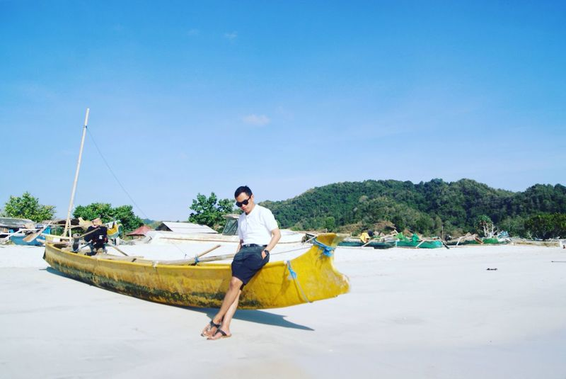 Real People Casual Clothing Nautical Vessel Full Length One Person Mode Of Transport Young Adult Transportation Water Sky Leisure Activity Outdoors Young Men Day Lifestyles Blue Beach Vacations Nature Tree