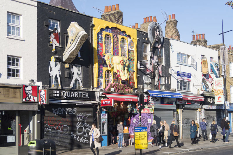 London, United Kingdom - October 9, 2018; Colorful, artistic facades of a street in Camden Town, close to Camden martket, famous for the market and alternative shops Camden Town Camden Market, London London United Kingdom Building Exterior Built Structure City Life Street Group Of People Tourism Shops Stores