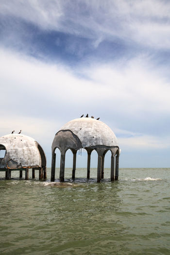 Blue sky over the Cape Romano dome house ruins in the Gulf Coast of Florida Cape Romano Dome House Ruins Wreck Abandoned Blue Sky Cape Romano Cloud - Sky Day Dilapidated Dome Home Dome Homes Dome House Dome Houses Erosion Landscape Nature No People Ocean Outdoors Sky Water Waterfront Wreckage Wrecked