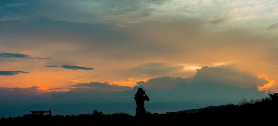 going to the sunset Hoàng Hôn Nightfalling Nightphotography Arms Raised Beach Beauty In Nature Cangio Cloud - Sky Land Lifestyles Nature Nightfall One Person Orange Color Outdoors Real People Sea Silhouette Sky Standing Sunset