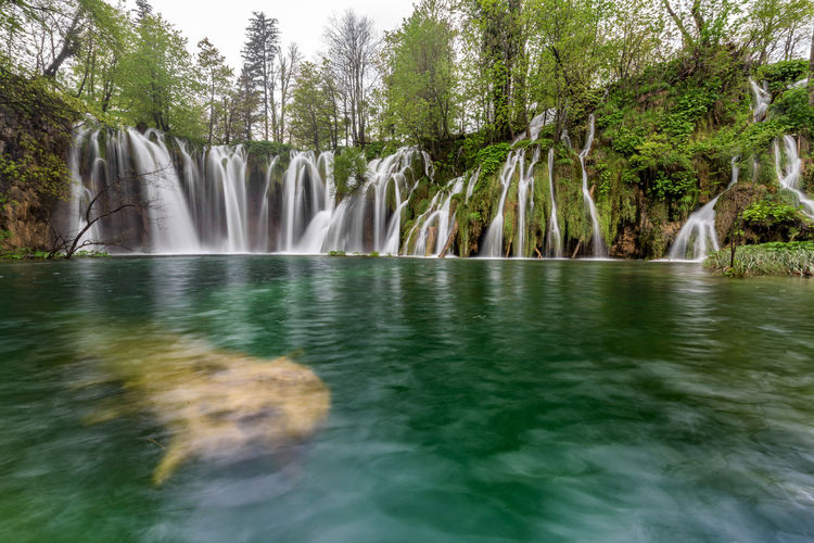 Beauty In Nature Flowing Flowing Water Green Color Idyllic Landscape Motion Nature No People Non-urban Scene Outdoors Plitvice Plitvice National Park Remote Scenics The Great Outdoors - 2016 EyeEm Awards Tourism Tranquil Scene Tranquility Travel Destinations Water Waterfall Waterfront
