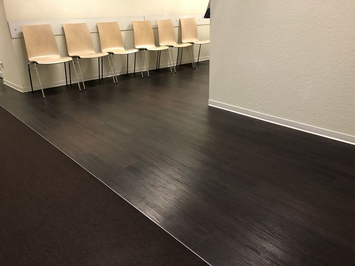 High angle view of empty chairs on hardwood floor