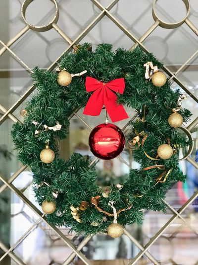 Christmas Holiday Decoration Christmas Decoration christmas tree Christmas Ornament Green Color Celebration Indoors  Tree Hanging No People Close-up Religion Holiday - Event Red High Angle View