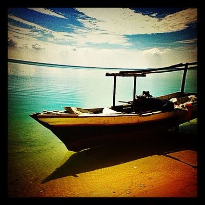 Perahu nelayan Iphonesia Hefe Instamood Pimpmyphoto beach boat cloud fisheye Photo courtesy by @ajieyoga