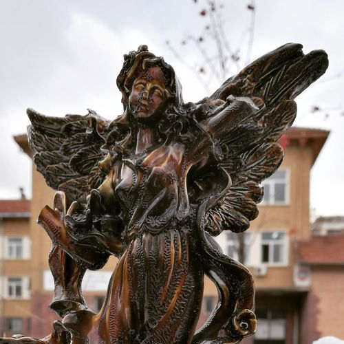 EyeEm Selects Outdoors Day Adult Sky People Angel Angel Statue Angel Wings Angels Statue Statues And Monuments Statue In The City