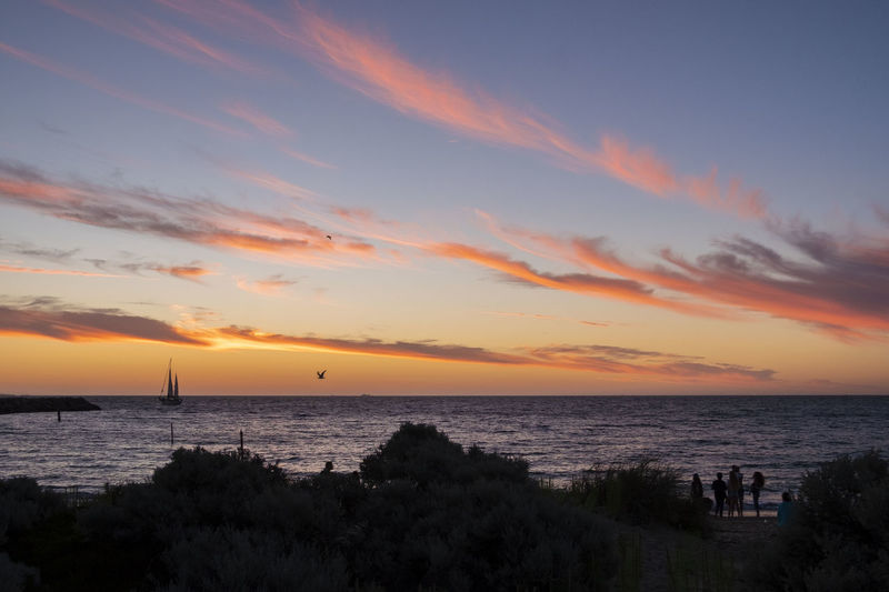 Evening scene Australia Fremantle, Western Australia Architecture Beach Beauty In Nature Beutifuldestination Birds Cloud - Sky Horizon Horizon Over Water Idyllic Land Nature No People Orange Color Outdoors Sailboats Scenics - Nature Sea Silhouette Sky Sunset Tranquil Scene Tranquility Water