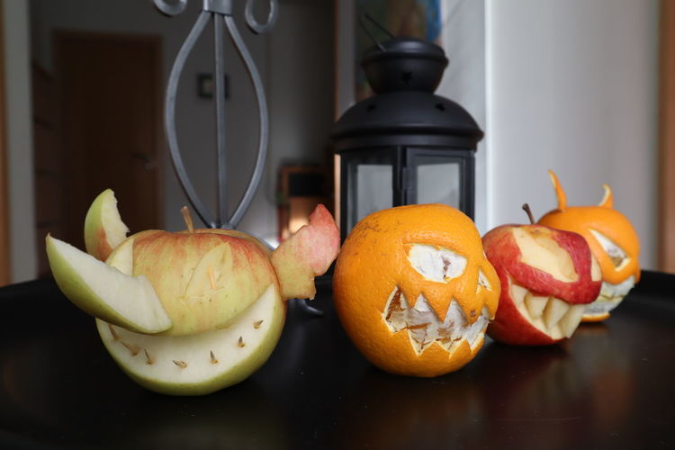 Food And Drink Food Fruit Still Life Freshness Apple - Fruit Indoors  Healthy Eating Table Pumpkin No People Halloween Anthropomorphic Wellbeing Anthropomorphic Face Creativity Close-up Face Orange Color Vegetable Jack O' Lantern Orange