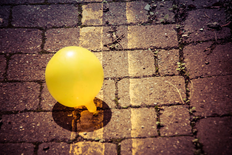 Yellow Footpath Street Paving Stone No People City Day Balloon Sunlight Stone Cobblestone High Angle View Nature Close-up Outdoors Sidewalk Shadow Brick Pattern Double Yellow Lines