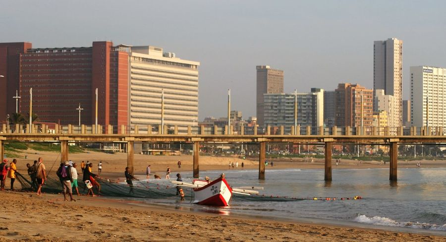 netting City Day Durban Beachfront Early Morning Fishermen's Life Fishing Boat Lifestyles Netting Outdoors Shore Tourism Urban Skyline Lost In The Landscape
