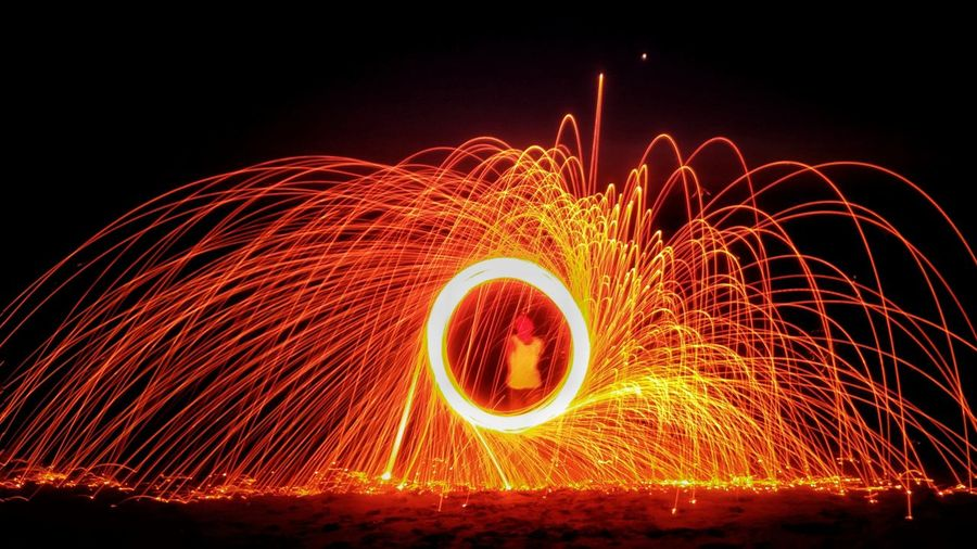 Person With Illuminated Wire Wool At Night
