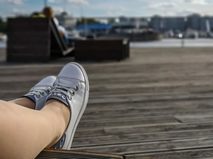 Low section of woman wearing canvas shoes