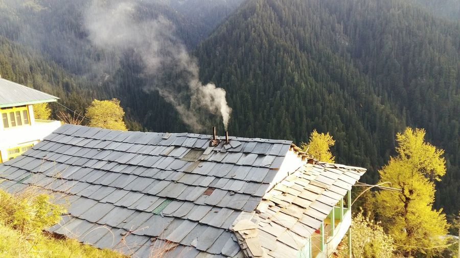 High angle view of smoke from chimney on residential house