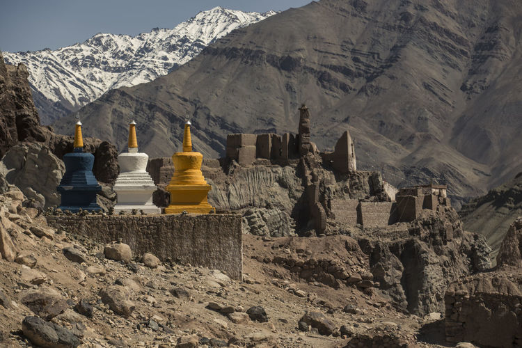 Three colourful buddhist religious stupas at Leh, Ladakh, Jammu and Kashmir, India Stupa Architecture Beauty In Nature Building Built Structure Cold Temperature Colorful Day Formation Leh Mountain Mountain Range Nature No People Outdoors Rock Rock - Object Rock Formation Rocky Mountains Scenics - Nature Sky Snowcapped Mountain Solid Sunlight Winter