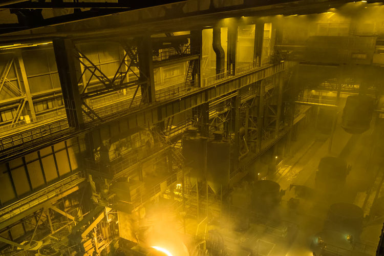 Illuminated Architecture Built Structure Industry Night Building Exterior Factory Motion No People Metal Blurred Motion Business Low Angle View Yellow Industrial Equipment Connection Production Line Outdoors Transparent Food Processing Plant