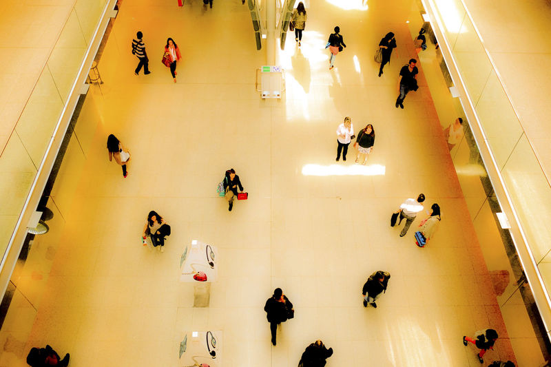 High angle view of people in shopping mall at station