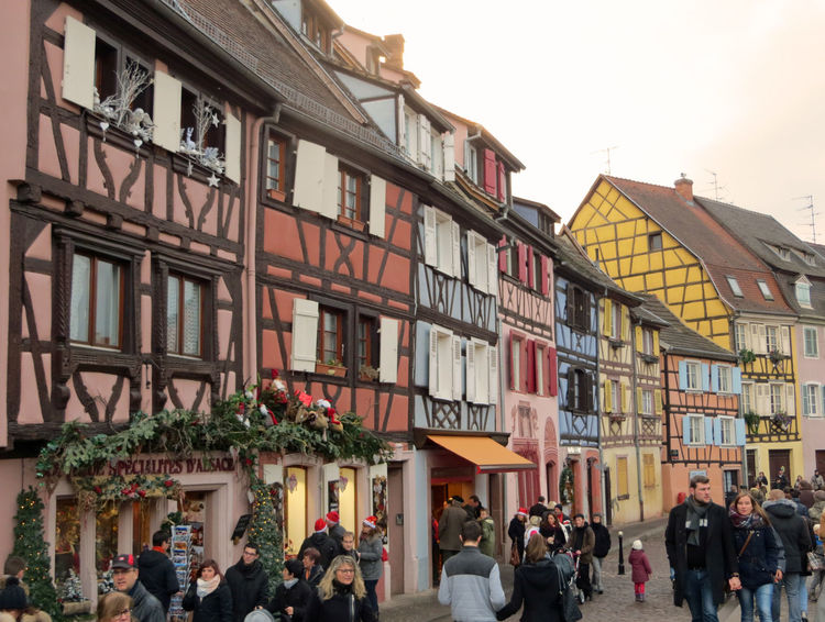 Advent Architecture Building Exterior Built Structure Christmas Market Christmas Shopping City Colorful Houses Crowded Street Day Foggy Day Large Group Of People Market Outdoors People Strolling Presents Security Shopping