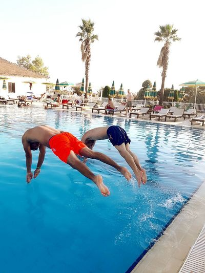 Swimming Pool Water Swimming Vitality People Togetherness Adult Adults Only Sport Day Exercising Healthy Lifestyle Lifestyles Outdoors Competition Young Adult Men Flexibility Only Women Teamwork