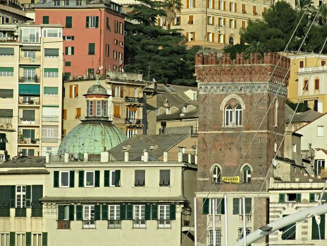 Different buildings. If you're thinking what it means the yellow flag on the tower on the right, it means selling. Anyone wants to buy a medieval tower in Genoa? :) Buildings Skrill IT Far From Home EyeEm Best Shots Cityscape