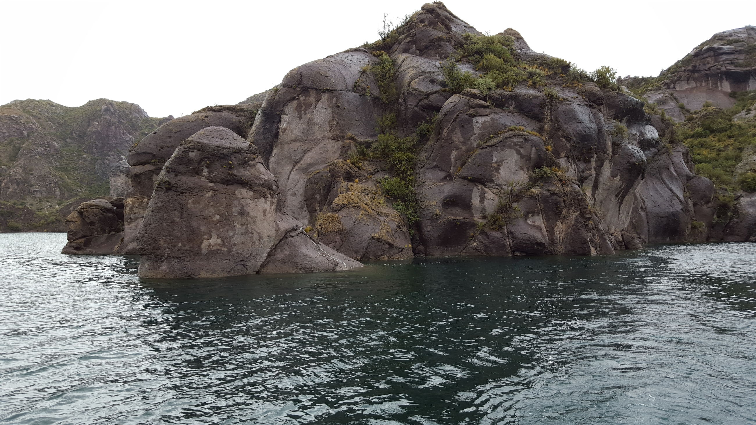 rock formation, rock - object, nature, waterfront, beauty in nature, no people, water, tranquility, scenics, day, outdoors, mountain, sea, sky