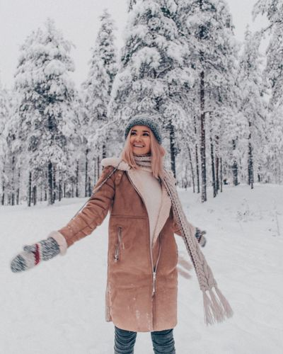 Winter One Person Cold Temperature Snow Warm Clothing Happiness Clothing Women Standing Nature Smiling Plant Leisure Activity Front View Females Scarf Tree Adult Enjoyment Hair