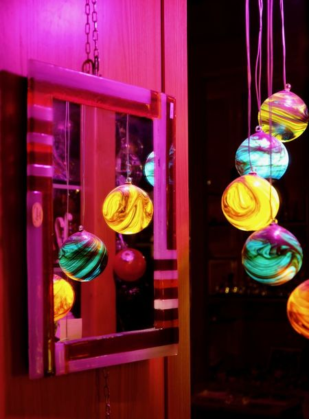 Getty X EyeEm Architecture Built Structure Close-up Color Colorful Decoration Electric Lamp Focus On Foreground Glass - Material Glowing Hanging Illuminated Indoors  Lighting Equipment Multi Colored Night Nightlife No People Purple Store Technology Transparent Window Yellow