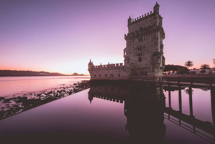 Reflection of Belem tower right after sunset Architecture Built Structure Travel Destinations Lisbon Portugal Europe Water Reflection Building Exterior Sky Waterfront Sunset History Nature The Past Building Lake No People Travel Clear Sky Tourism Outdoors Purple