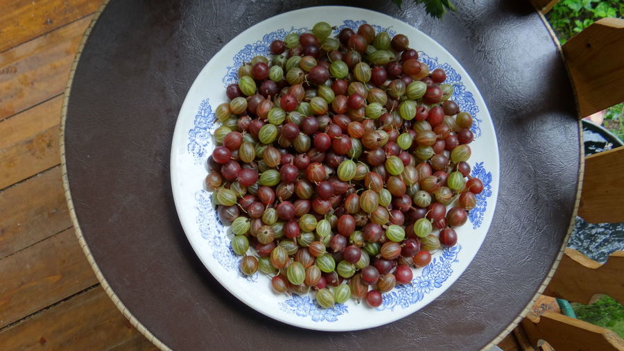 Directly Above View Of Gooseberries In Plate On Table
