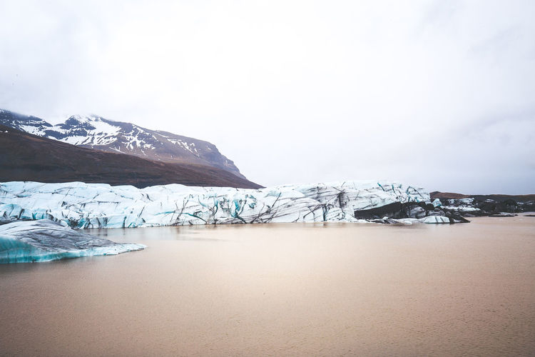 Days of travel: 7 - Svinafellsjokull glacier Iceland Beauty In Nature Cold Temperature Day Dreamy Environment Glacier Ice Iceberg Landscape Melting Mountain Mountain Peak Nature No People Outdoors Scenery Sky Snow Snowcapped Mountain Tranquil Scene Tranquility Water Wilderness Winter My Best Travel Photo