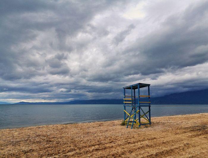 Somewhere Water Sea Beach Sand Lifeguard  Lifeguard Hut Blue Summer Sky Horizon Over Water Lookout Tower Beach Hut Calm Lakeside