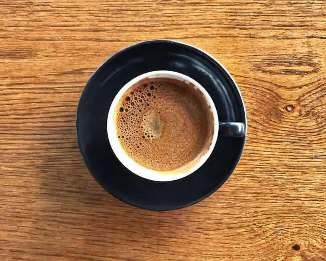 Turkish Coffee Drink Food And Drink Directly Above Refreshment Table Still Life Coffee - Drink No People Crockery Brown Frothy Drink Coffee Cup Wood - Material Coffee Close-up Freshness Mug Indoors  Food Cup Springtime Decadence