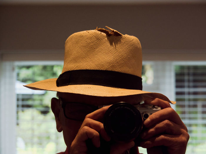 Awaiting repair Camera Work Panama Hat Clothing Hat Headshot Leisure Activity Lifestyles Men One Person Portrait Real People