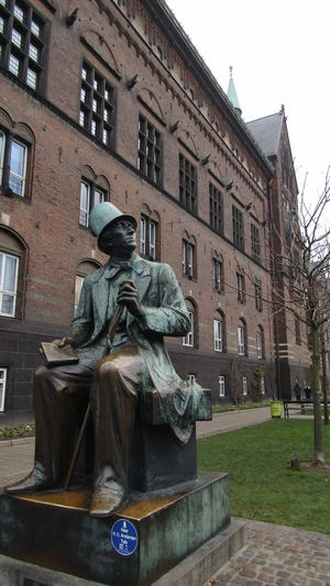 Statue against historic building in city