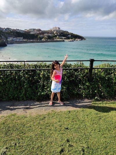 Portrait of girl standing against sea