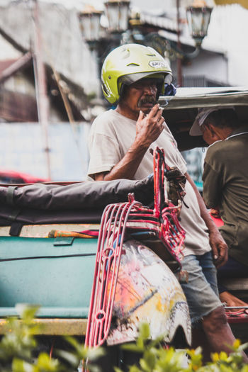 sabar menanti rezeki Humaninterest Humaninterestphotography Streetphotography Jogja Yogyakarta Work Headwear Nautical Vessel City Sitting Men