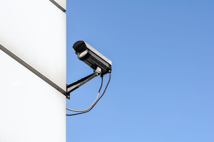 surveillance camera Securety Architecture Big Brother - Orwellian Concept Blue Blue Sky Building Exterior Built_Structure Clear Sky Controll Day Low Angle View No People Outdoors Safety Security Camera Sky Surveillance Technology Terrorism Video Fresh On Market 2017