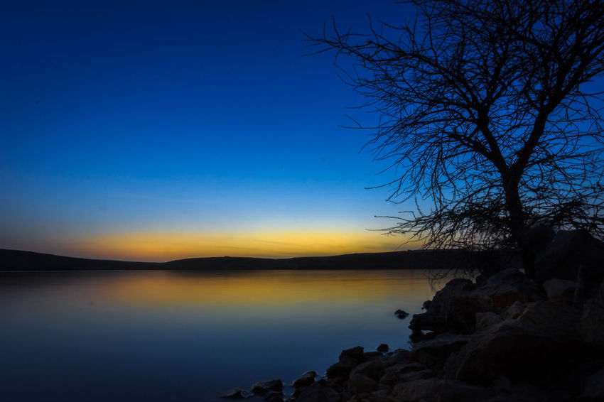 Sky Silhouette Nature Beauty In Nature Sunset Scenics Blue Water No People Tranquil Scene Tranquility Night Tree Outdoors Landscape Sea Horizon Over Water Bare Tree Clear Sky Astronomy Azzydoon Riyadh KSA River Tourism The Weekly Eyeem EyeEmNewHere