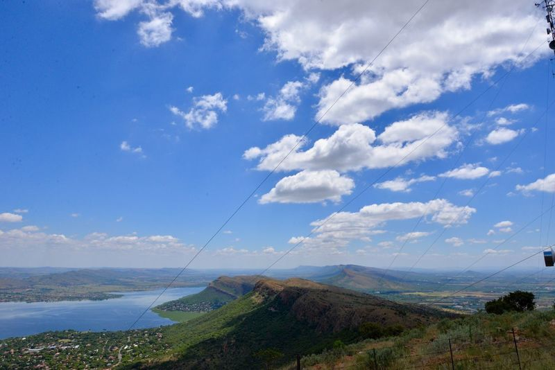 Hartebeespoort dam and Magalies berge. Travelling Hartbeespoort Dam South Africa Hartbeespoort Dam Wall Hartebeespoort Sky Tranquil Scene Scenics Tranquility Day Beauty In Nature Cloud - Sky Outdoors Nature No People Landscape Mountain Blue Grass Harties Water Travel Destinations Nature Tranquility
