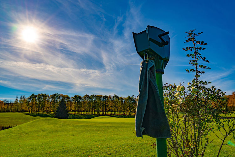 Golfclub Dresden Elbflorenz - golf ball washer at the tee #7 with view to green #6 | Rose - Flower Autumn Golfing Golf Club Golfcourse Golf Arms Raised Outdoors Blue Beauty In Nature Tranquil Scene Tranquility Cloud - Sky Landscape No People Day Tree Sunlight Field Grass Green Color Nature Plant Sky EyeEmNewHere