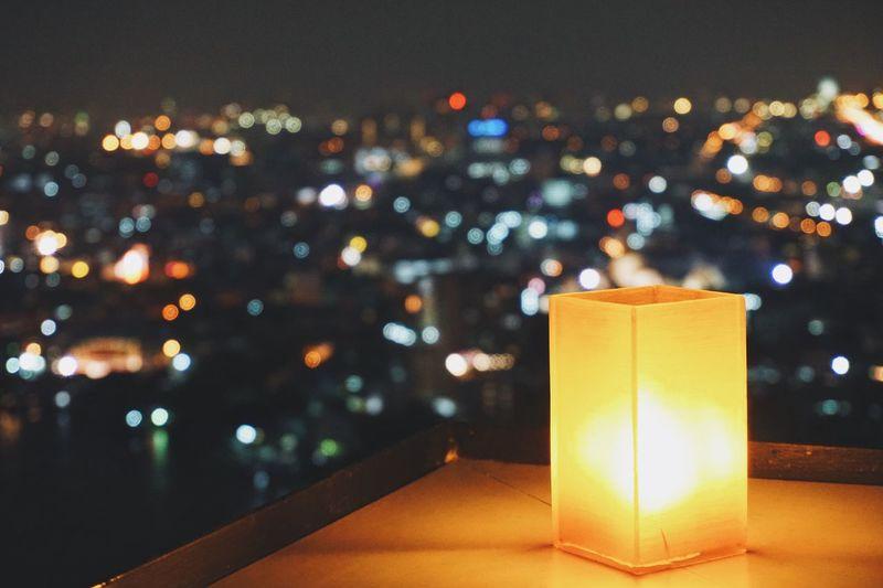 Night Glowing City Candle Bokeh Lights Illuminated Table
