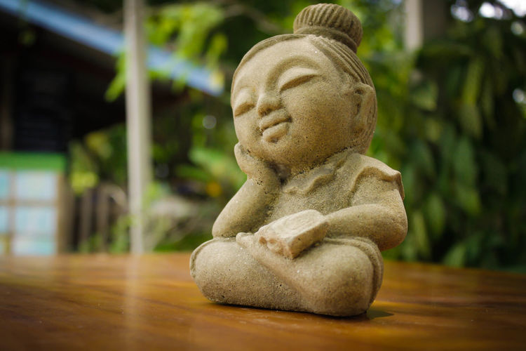 Close-up of figurine on wooden table