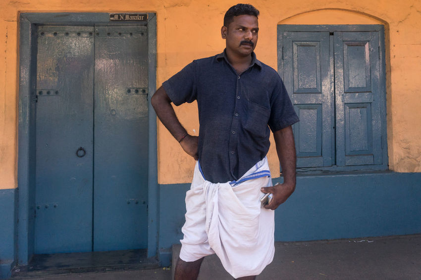 Man in Blue, Thrissur, Kerala Color Colorful Colors Confidence  India Kerala Kollam Lifestyles Muscular Build One Man Only One Young Man Only People Portrait Real Life Real People Real People Photography Real People, Real Lives Standing Street Photography Streetphotography Strength Travel Travel Destinations Travel Photography Young Adult