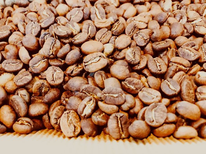 Textures and Surfaces Coffee Bean Food And Drink Large Group Of Objects Food No People Close-up Indoors  Backgrounds Raw Coffee Bean Freshness